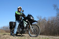 Man on motorcycle adventure shown in off road wilderness area Royalty Free Stock Image