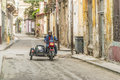 Man on motorcycle with sidecar havana driving a in old cuba Stock Photos