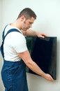 Man mounting TV. Royalty Free Stock Photo