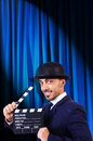 Man with movie clapper on curtain background Royalty Free Stock Photos