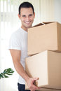 Man on moving day young holding and carrying cardboard box Stock Photo