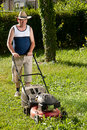Man mowing the lawn Stock Photo