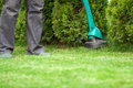 Man mowing lawn grass trimmer Royalty Free Stock Photo