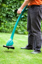 Man mowing lawn with grass trimmer Royalty Free Stock Photo