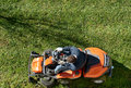 Man mowing a lawn on a ride-on mower Royalty Free Stock Photo