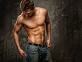 Man with muscular torso young body in blue jeans Royalty Free Stock Photo