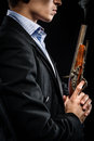 Man with musket side view Stock Photos
