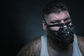 Man in muzzle adult agressive the dark Royalty Free Stock Photography