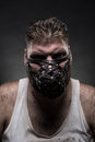 Man in muzzle adult agressive over dark background Royalty Free Stock Photography