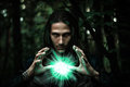 Man with a mysterious glowing orb. Royalty Free Stock Photo