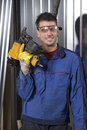 Man with nail gun at workshop Stock Photo