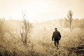 Man in nature old taking a morning walk misty Stock Photography