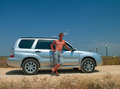 Man near the car handsome young with a naked torso Royalty Free Stock Photos