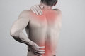Man with neck and back pain. Man rubbing his painful back close up. Pain relief concept Royalty Free Stock Photo