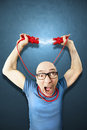 Man need energie holding red elettric wires Royalty Free Stock Photo