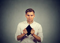 Man with no money holding empty wallet Royalty Free Stock Photo