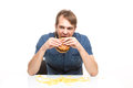 Man is not careful eating tasteless burger drops potatoes Royalty Free Stock Image