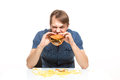 Man is not careful eating tasteless burger drops potatoes Stock Photography