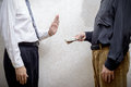 Man Offering  a Dollars bribe to a Man Refusing it Royalty Free Stock Photo