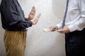 Man Offering  a Hryvnia bribe to a Man Refusing it Royalty Free Stock Photo