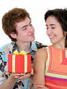 Man Offering Present to Girlfriend Stock Photos