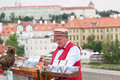 Man offers music from hand operated music box in exchange for money on charles bridge on july in prague czech republic Royalty Free Stock Photo