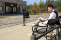 Man in old town relaxing sitting on bench reading book Royalty Free Stock Photo