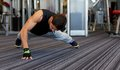 Man one arm push ups in gym fitness sport people and lifestyle concept doing Royalty Free Stock Images
