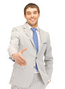 Man with an open hand ready for handshake handsome Stock Images