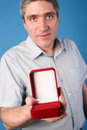 Man with an open red gift box holds in hand Royalty Free Stock Photo
