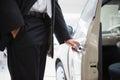 Man opening a car door Royalty Free Stock Photo