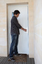 Man opening door Stock Image