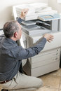Man opening photocopier in office business photocopy machine Royalty Free Stock Photography