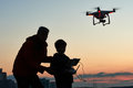 Man operating of flying drone at sunset Royalty Free Stock Photo