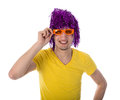 Man with orange glasses and purple wig isolated over white Stock Photos