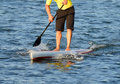 Man on a paddle board in ocean the Stock Image