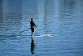 Man on paddleboard in Dana Point Harbor, California. Royalty Free Stock Photo