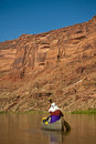 Man paddling canoe in desert canyon river Stock Photos