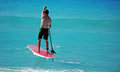 Man paddling out on paddle board Stock Image
