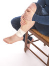 Man with a painful leg on white background Stock Photo
