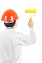 Man with paint roller rear view of the in hard hat isolated on the white background Royalty Free Stock Photography