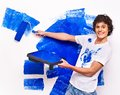 Man paint wall at home happy Stock Photo