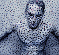 Man painted white dots Stock Photo