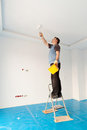 Man painting ceiling Royalty Free Stock Photography