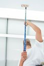 Man painting ceiling of home low angle view Royalty Free Stock Images