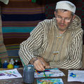 A man painting on paper in biblical village the biblical village is the first project in europe organized in bucharest at titan Royalty Free Stock Images
