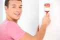 Man painting wall using red color closeup view of guy decorating house Stock Photo