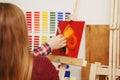 Man paints with oil paints