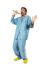 Man in pajamas singing a into an imaginary microphone Royalty Free Stock Photo
