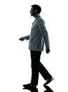 Man pajamas walking one in silhouettes on white background Stock Photos